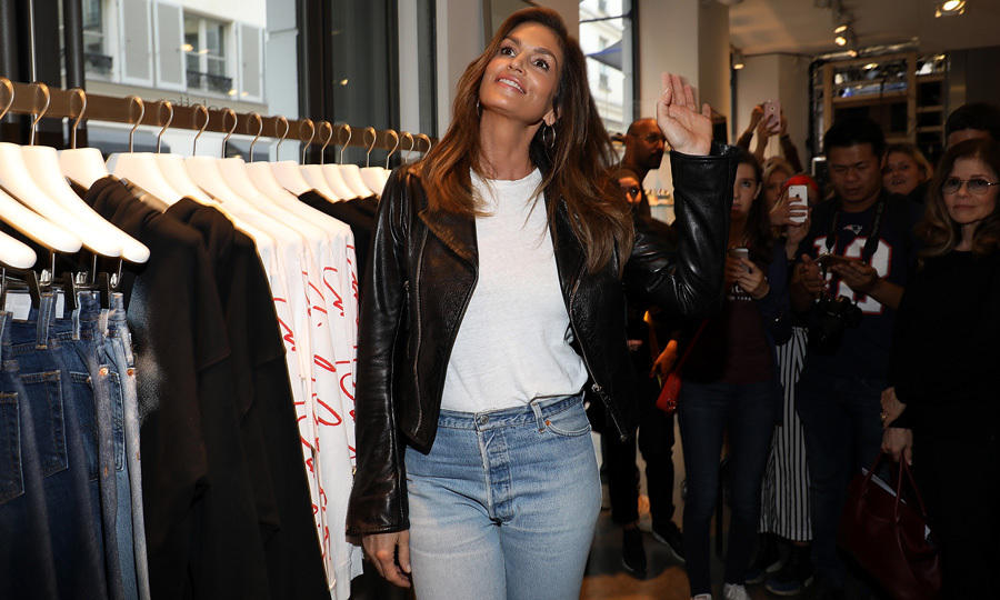 Cindy Crawford kept it casually chic in a leather jacket, white t-shirt and jeans by Re/Done at Colette in Paris where she signed copies of her book <I>Becoming</I>.