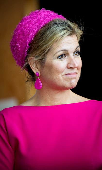 Bright colors suit Queen Maxima of the Netherlands perfectly – so much so that she wore this fuchsia tone head to toe (statement earrings and hat included) during a June 2017 museum visit in Urk. 