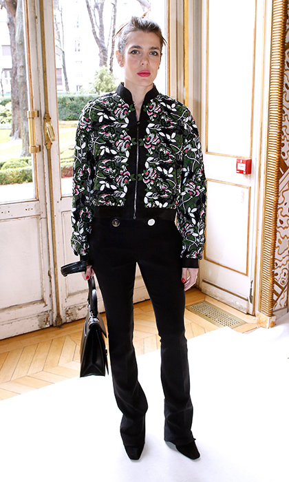 Charlotte doesn't often wear pants but when she does she keeps it simple and chic. A floral bomber adds the perfect flair to black trousers at Giambattista Valli's Paris Fashion Week Fall/Winter 2017/2018 presentation.