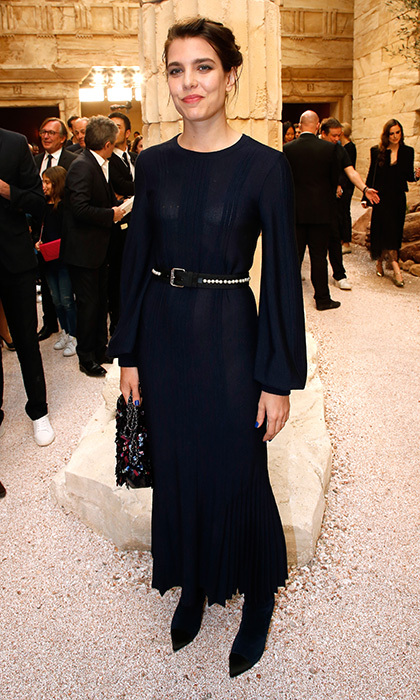 Ms Casiraghi proved a navy dress doesn't have to be boring with this bell-sleeved creation with studded belt at the Chanel Cruise 2017/2018 collection in Paris. 