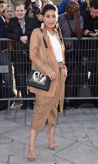 The Paris Fashion Week style parade seemed to never stop for Princess of Thailand Sirivannavari Nariratana, who stepped out on day eight for the Louis Vuitton Spring/Summer 2018 womenswear presentation on October 3. The royal went for nude tones from head to toe, making a statement with her gold earrings and covetable LV purse. 