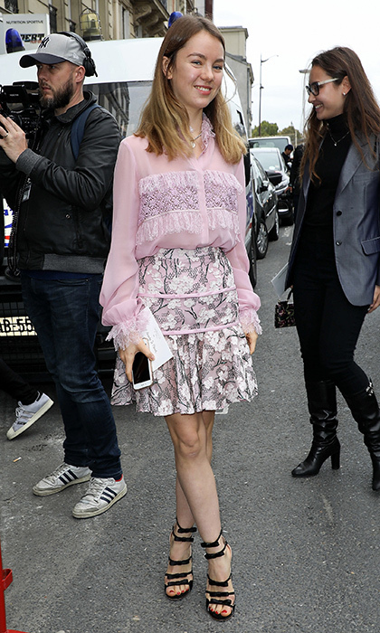 The younger of Princess Caroline's daughters, 18-year-old Princess Alexandra of Hanover, was pretty in pink at the Giambatista Valli Spring/Summer 2018 show during Paris Fashion Week on October 2. The royal wore a pretty blouse and skirt by the Italian designer – who is also a favorite of Princess Alexandra's sister Charlotte Casiraghi – along with cool bow-bedecked sandals.