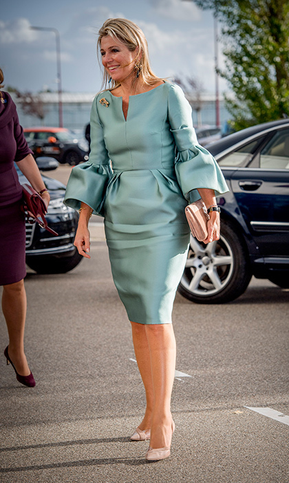 The Dutch Queen wore a bell-sleeved tailored silk dress in a mint hue with powder pink accessories as she arrived at the King Willem I lecture at Koppert Cress in Westland, Netherlands on October 3. Queen Maxima is the honorary chairwoman of the King Willem I Foundation, which highlights and rewards Dutch entrepreneurship. 