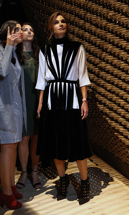One of the world's most well-dressed royals, Queen Rania of Jordan once again proved her style credentials during a visit to one of her initiatives, Amman Design Week, at the Ras el Ain gallery in downtown Amman, Jordan, on October 4. The royal was chic in black and white graphics with cage-style heels.