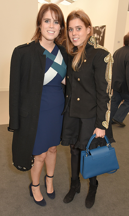 Talk about some stylish sister bonding! Princess Beatrice and Princess Eugenie both wore a bit of blue as they checked out the Frieze Art Fair 2017 VIP Preview together in Regent's Park on October 4. Eugenie, 27, wore a color block dress in the tone, while sister Beatrice, in a military-style jacket, carried a cobalt handbag.