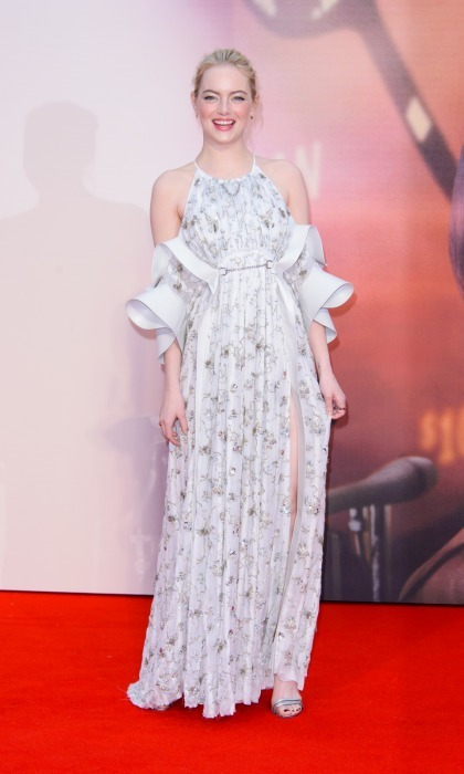 Emma Stone dazzled at the European premiere of her film <I>Battle of the Sexes</I>. The 28-year-old actress turned heads as she walked the carpet during the 61st BFI London Film Festival in England on October 7. Opting for a whimsical vintage-inspired Louis Vuitton gown, which featured: open shoulders, ruffled sleeves and silver detailing, Emma shimmered. The star was recently named an ambassador for the fashion company.