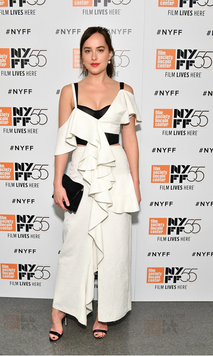 Dakota Johnson was stylish in a white and black jumpsuit during the screening of <I>Call Me by Your Name</I> at the New York Film Festival.