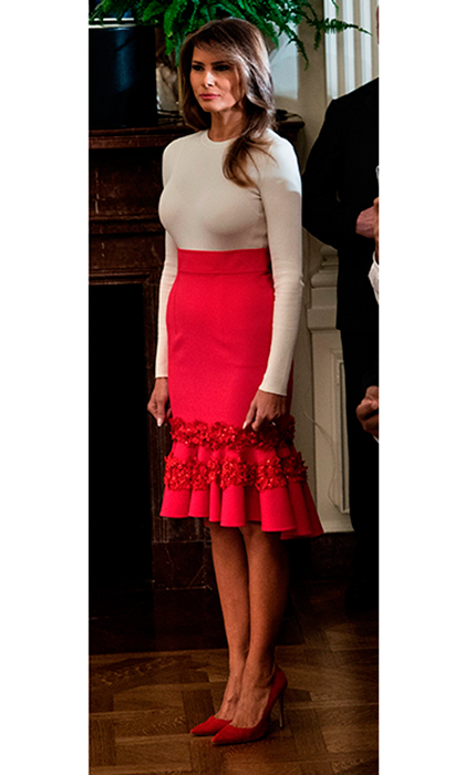Melania donned a red ruffled skirt by Venezuela-born Carolina Herrera for a Hispanic Heritage Month event held in the East Room of the White House on October 6. President Trump and Melania hosted around 200 Hispanic business, community, and faith leaders, and guests from across the country to help mark the annual occasion. 
