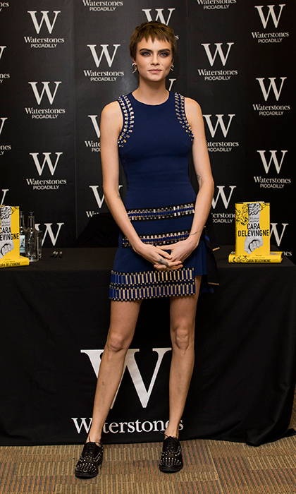 Model-turned-actress-turned-author Cara Delevingne wore a deep blue bodycon dress by David Koma at her book signing at Waterstones Piccadilly on October 4 in London. Cara just released her debut Young Adult novel, <I>Mirror, Mirror</I>.