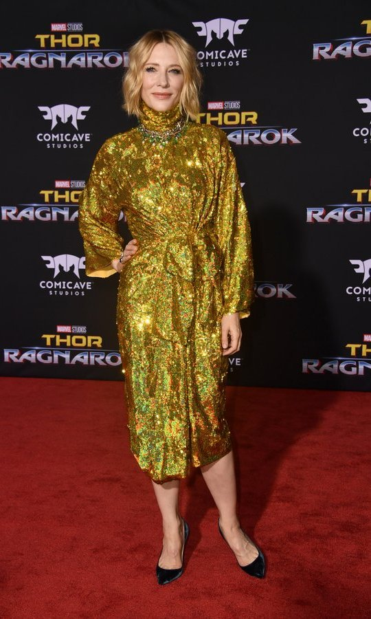 Cate Blanchett certainly went for the gold at the <I>Thor Ragnarok</I> premiere in Hollywood! The Oscar winner wore a turtleneck Gucci dress covered in gilded sequins for the movie's red carpet.