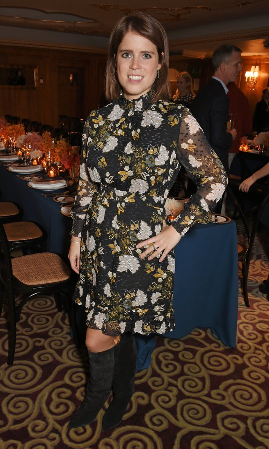Princess Eugenie of York wore the season's perfect uniform, a dark floral shirtdress and knee-high boots, to a private dinner following the Warrior Games Exhibition VIP Preview, hosted by the princess, actor-designer Waris Ahluwalia and beauty guru Sylvie Chantecaille at The Westbury, A Luxury Collection Hotel, Mayfair on October 11 in London.