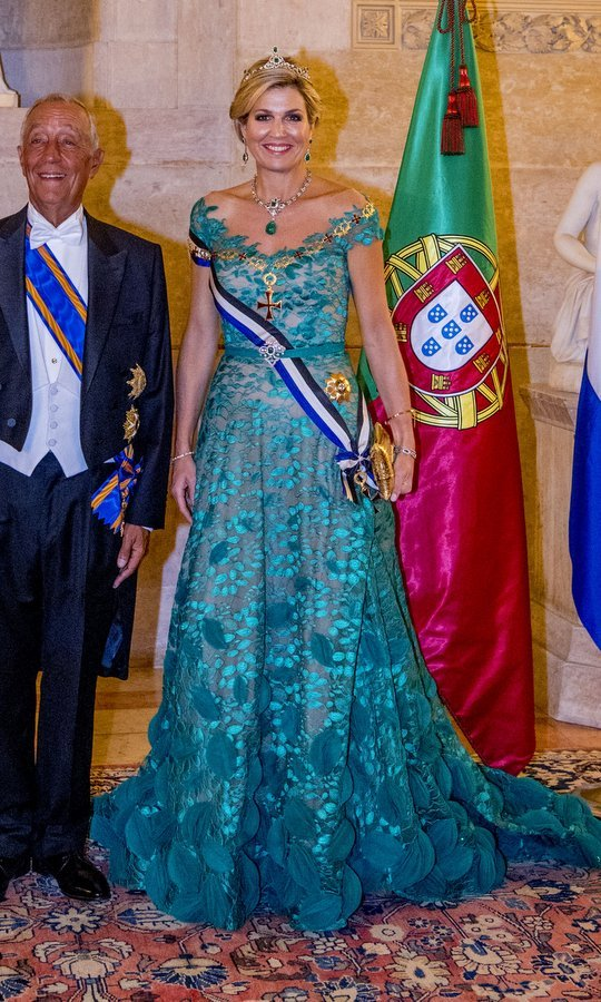 For an official state banquet hosted by Portugal's President Marcelo Rebelo de Sousa at the Ajuda Palace, Queen Maxima wore an emerald green of the shoulder gown with – what else? – emerald jewels, including a stunning tiara. 