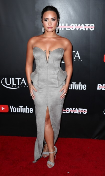Demi Lovato rocked the L.A. carpet for the premiere of her YouTube doc <i>Demi Lovato: Simply Complicated</i> on October 11. The 25-year-old entertainer wore a silver strapless Lexi dress, diamond jewelry and a gorgeous braid in her hair.