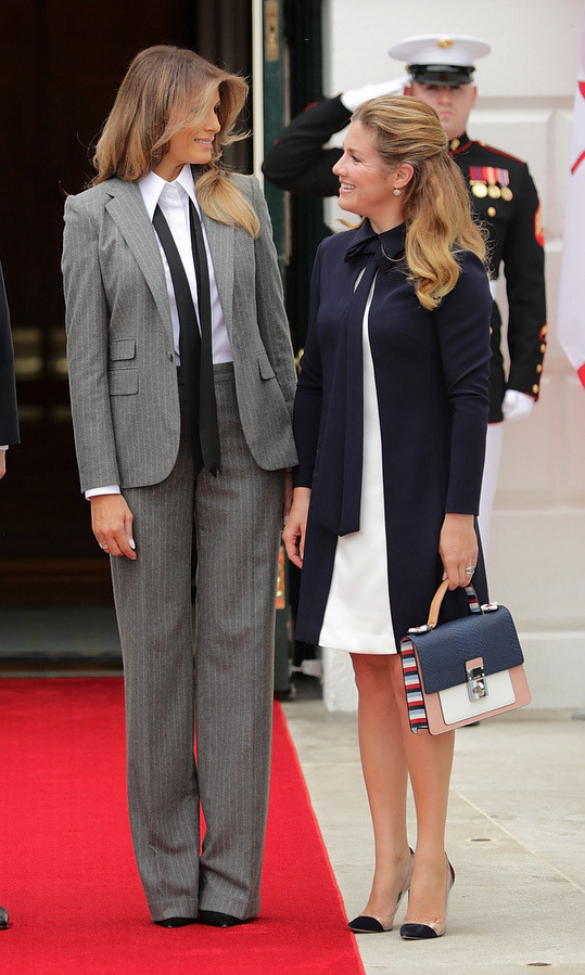 Melania swapped her usual ultra-feminine body-hugging oufits for a pinstriped business suit with loose tie as she greeted Canada's First Lady Sophie Gregoire Trudeau  at the White House on October 11. The look – which fits right in with fall's masculine trend – is by Ralph Lauren Collection.