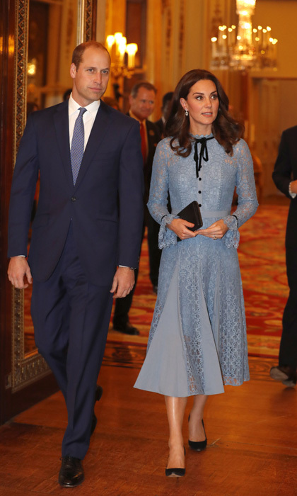 Kate Middleton stepped out for the first time since announcing her third pregnancy with her husband Prince William and brother-in-law Prince Harry, during a Buckingham Palace reception celebrating the contribution of those working in the mental health sector on World Mental Health Day. The Duchess, who showed off her bump in a blue dress by Temperley, has been out of the spotlight due to her battle with severe morning sickness.