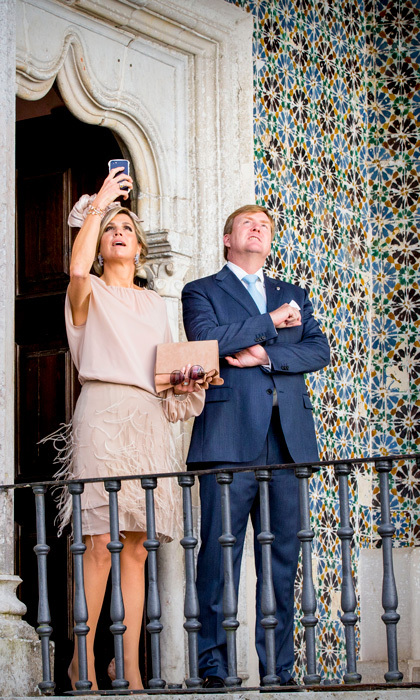 Queen Maxima of the Netherlands could not resist snapping a photo with her phone at the Palacio da Vila during her and husband King Willem-Alexander's royal trip to Portugal.