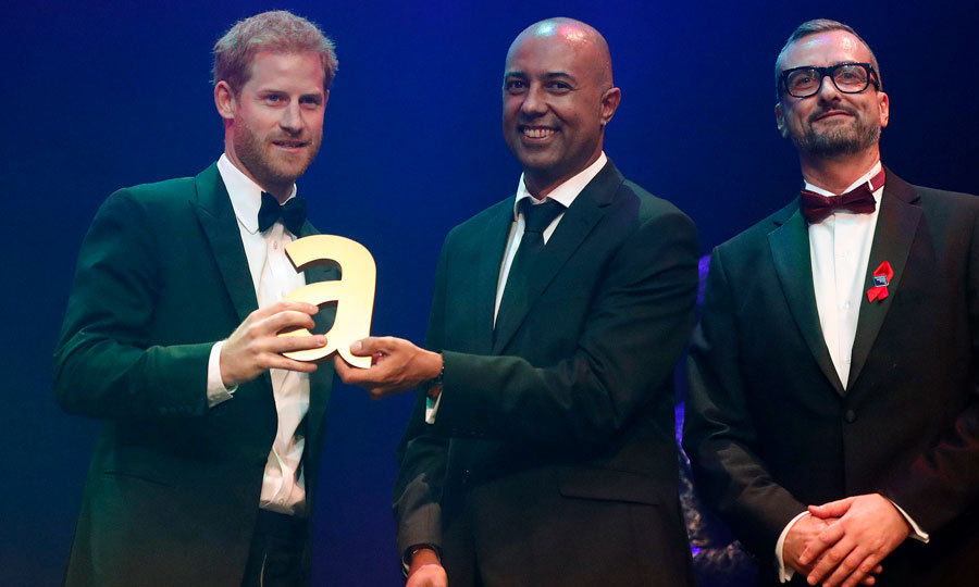 "Prince Harry accepted the posthumous Attitude Legacy Award on behalf of his late mother Princess Diana on October 12 in London. The 33-year-old Prince, who dressed up in a tux for the occasion, spoke about his mother's work, drawing attention and removing the stigma surrounding HIV and AIDS. ""She knew that AIDS was one of the things that many wanted to ignore and seemed like a hopeless challenge,"" Meghan Markle's boyfriend said via BBC.