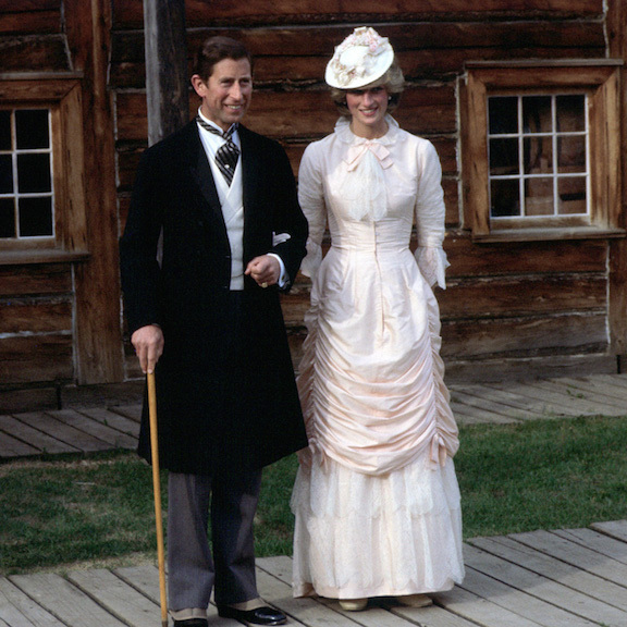 Prince Charles and Princess Diana got dolled up in Klondike fashion during their 1983 royal tour of Canada. The Princess of Wales looked elegant in an elaborate white number and matching fascinator, while Charles suited up and accessorized his look with a cane.