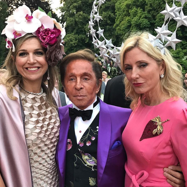 Crown Princess Marie-Chantal of Greece (right) got dolled up for her daughter and husband's Prince and the Revolution-themed birthday celebration in 2017. The Greek royal stunned wearing a vibrant hot pink dress, which she paired with a show-stopping fascinator by Philip Treacy. Queen Maxima of the Netherlands (left) also got into the spirit stepping out in an elaborate floral headpiece.
