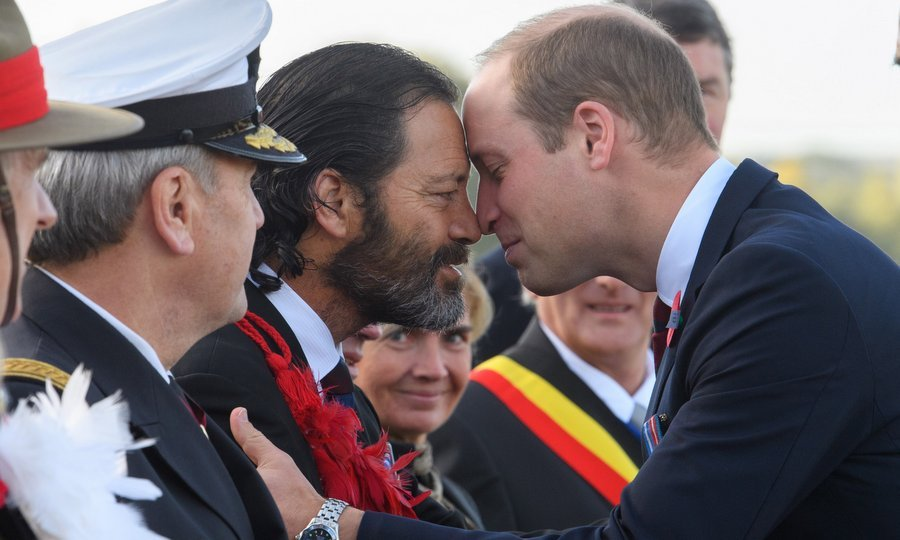 Up close and personal.  Prince William, Duke of Cambridge, shared a traditional Maori greeting as he was welcomed by Former Corporal in the New Zealand Special Air Service, and Victoria Cross awardee, Bill Henry 'Willie' Apiata. The special moment took place at the New Zealand Memorial Wall to the Missing during the Commemoration for the Battle of Passchendaele at Tyne Cot Cemetery on October 12 in Flanders, Belgium. 