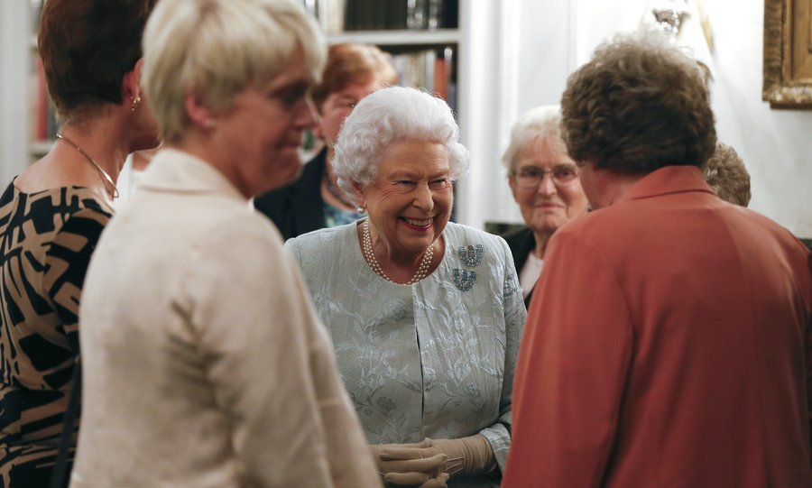 The 91-year-old monarch seemed to be having quite the good time, smiling throughout as she chatted with guests at a Women's Royal Naval Service 100 project reception.