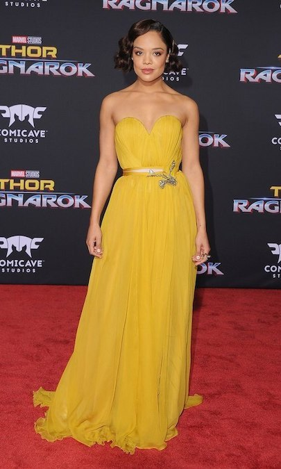 Tessa Thompson looked like a princess at the Los Angeles premiere of Disney and Marvel's Thor: Ragnarok in October 2017. The star wore a silk chiffon strapless yellow gown by Schiaparelli haute couture.