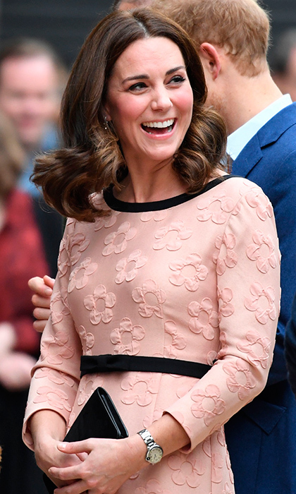 Keeping us guessing: After wearing blue at her last engagement – causing some to speculate she will be having a boy – the Duchess opted for pink on Monday.