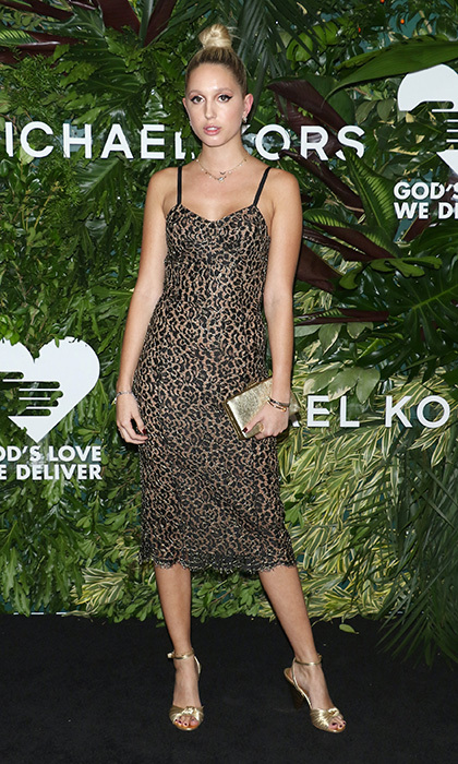 Princess Olympia of Greece is known for her fresh and modern style. Here the Michael Kors muse wears a lace animal print slip dress by the designer with metallic accessories to the Golden Heart Awards in NYC.