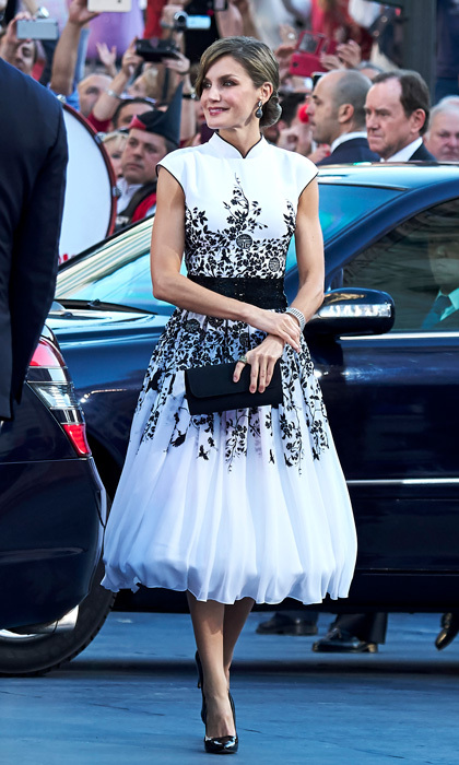 For the Princess of Asturias Awards ceremony on October 20, King Felipe VI's wife wore a white dress that featured black embroidery and a moat neckline with a full skirt. The Spanish royal swept her brunette tresses up in an intricate bun. 