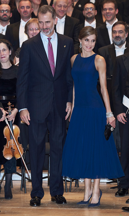 The day before — Thursday, October 19 — Letizia attended the awards' XVI Musical Week closing orchestral concert with her husband. The mom-of-two sported a wrap around ponytail for the occasion. The chic, albeit simple updo highlighted the royal's Yanes blue topaz chandelier earrings.