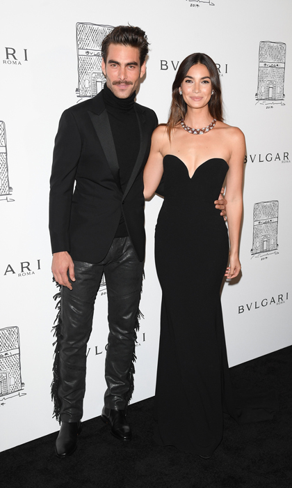 Lily Aldridge made a statement with her figure-hugging black gown by Alex Perry and Bulgari necklace next to Jon Kortajarena, who also turned heads in his fringed-leather pants, at the Bulgari reopening in NYC.