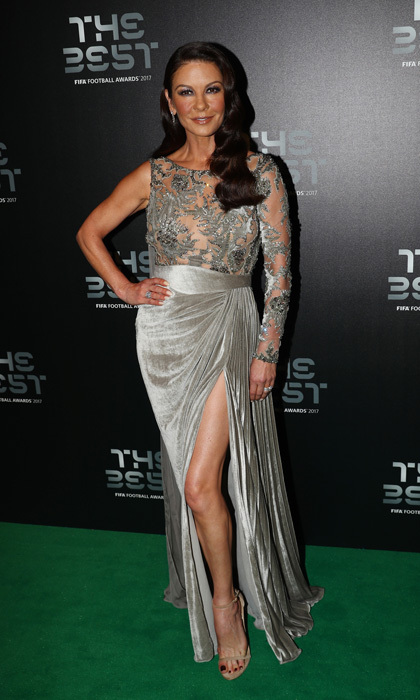 Catherine Zeta-Jones opted for a velvet and lace gown with a high thigh-slit for The Best FIFA Football Awards in London on October 23. The actress, who presented the Puskas Award for goal of the season, wore her hair to one side with big waves.