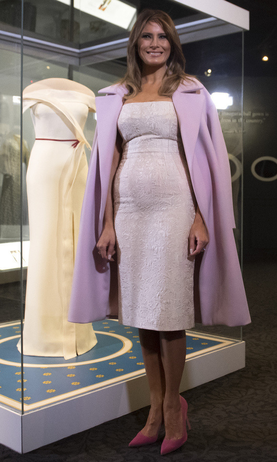 Melania wore a trio of her wardrobe staples – pointy-toed stilettos, a tailored dress and coat worn over her shoulders – as she unveiled the exhibition of her Hervé Pierre Inaugural Ball gown as part of the First Ladies Collection at the Smithsonian National Museum of American History in Washington, DC.
