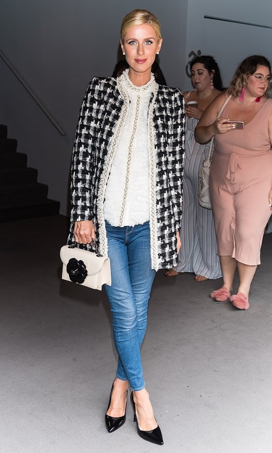 Nicky rocked the same Oscar de la Renta bag with gardenia flap along with her classic ensemble – jeans, a white blouse and tweed jacket – at the Alice + Olivia By Stacey Bendet fashion show during New York Fashion Week.