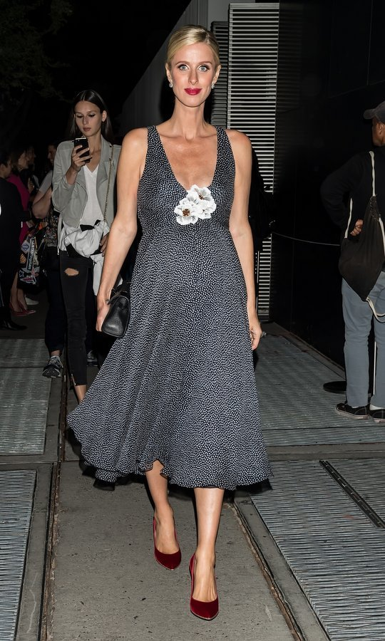 Carolina Herrera is another Nicky Hilton fave! Nicky was seen wearing this plunge-necked dress and burgundy high heels as she left the designer's presentation at The Museum of Modern Art during NYFW in September 2017.