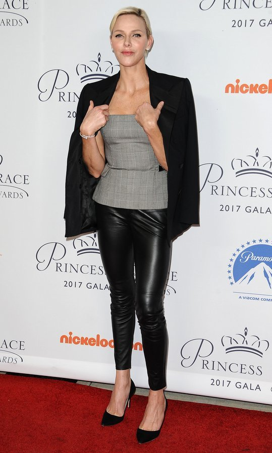 A day earlier, Prince Albert's wife showed off her edgier side in leather leggings, a Ralph Lauren glen check bustier top and tuxedo jacket for the 2017 Princess Grace Awards gala kick off event at Paramount in Los Angeles. She kept her red carpet accessories simple with a bracelet, stud earrings and black high heels.