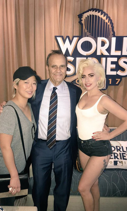 "Lady Gaga may have been in Los Angeles watching the Dodgers play the Houston Astros, but her heart was still in New York. She posted this photo with a friend and former NY Yankees manager Joe Torre during the game. She wrote on Twitter, ""When you got the best seat in the house. Next to Joe Torre and your best friend since you were 4.""