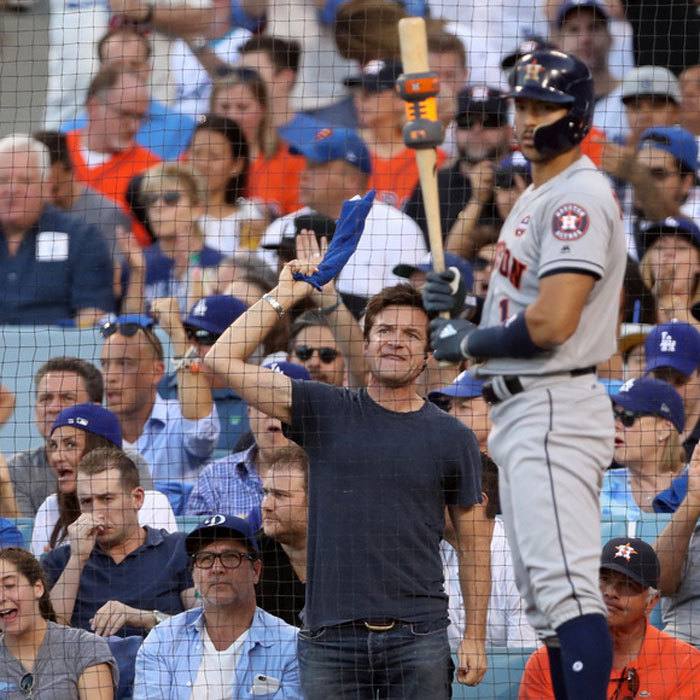 Jason Bateman tried to use his best tactics from his Netflix show <i>Ozark</i> to intimidate the Astros player ready to go to bat. The <i>Arrested Development</i> star kept it casual in a t-shirt and jeans despite the heat wave L.A. has been currently experiencing.