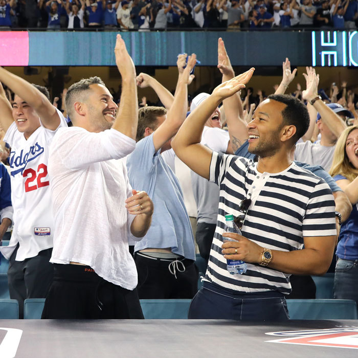 John Legend and his buddy Mike Rosenthal left their wives Chrissy Teigen and Jen Atkin at home for their boys' night out. The two, who often are the kings of travel with their significant others, gave each other a high-five at one point during the game.