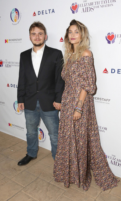 Paris and Prince Jackson held hands as the siblings made their way down the mothers2mothers and The Elizabeth Taylor AIDS Foundation Benefit Dinner. Instead of having a birthday party, Zac Posen co-chaired the evening with the budding actress and model at Ron Burkle's Green Acres estate in Beverly Hills.
