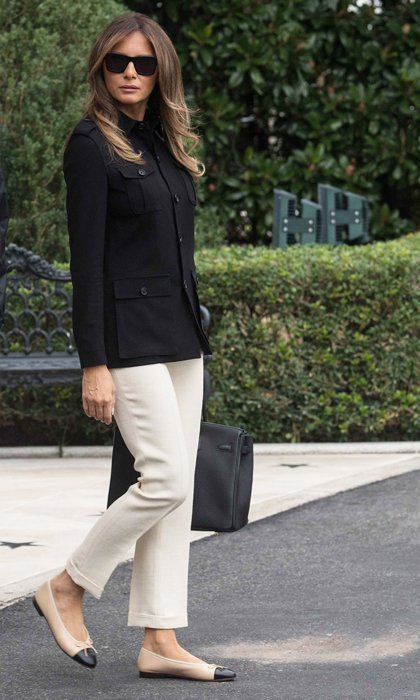 Barron Trump's mom stayed neutral on her way to Florida in Marine One in a structured black Ralph Lauren jacket and off-white capris. She paired the look with sophisticated Chanel ballet flats and a black leather Hermès Birkin bag.