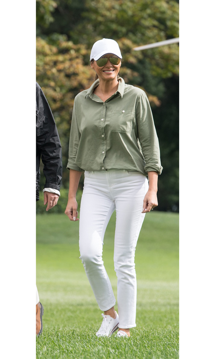 Upon her arrival to Fort Myers, Florida, Melania wore an olive green utility blouse, white jeans, baseball cap and Converse sneakers for a meeting with FEMA and Hurricane Irma volunteers.