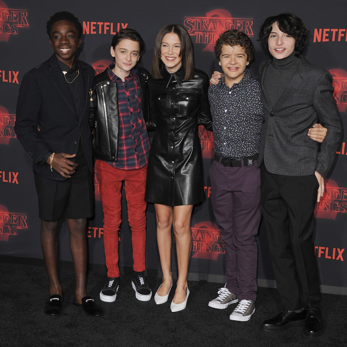 Millie Bobby Brown tested out a longer hairstyle on the carpet of the <i>Stranger Things 2</i> premiere at the Westwood Village Theater. For the Netflix star's big night, she opted for a leather dress with white kitten heels as she posed with her co-stars Caleb McLaughlin, Noah Schnapp, Gaten Matarazzo, and Finn Wolfhard.