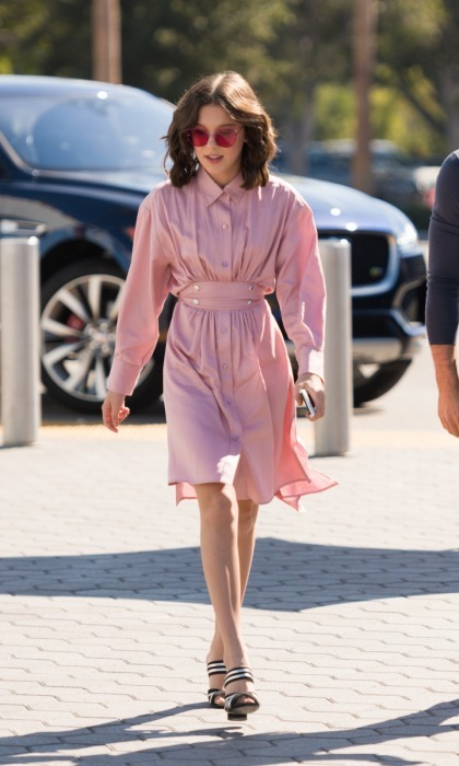 Millie Bobby Brown looked chic while out promoting the new season of her hit Netflix series <i>Stranger Things</i>. The 13-year-old fashionista visited Extra at Universal Studios Hollywood on October 27 in Universal City, California. She wore a pink dress, noticeably similar to one seen on her character Eleven, and accessorized with a matching pair of Gentle Monster shades, which retail for $249.00.