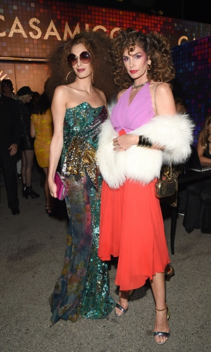 Amal Clooney and Cindy Crawford got groovy at the 70s-themed Casamigos 2017 Halloween Party on October 27 in L.A. The besties posed for photographers, showing off their glitzy outfits. Amal opted for a stunning sequin gown with bold make-up and gold-hoop earrings. Her model pal Cindy wore a bright halter-neck dress with fur shrug and curled hair. 