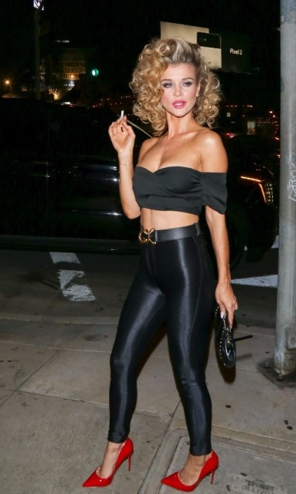 Model Joanna Krupa slipped into the iconic Sandy look from <i>Grease</i> for the Casamigos Halloween event. The 38-year-old looked incredible in the costume, as she strutted into the bash with the same swagger Sandy shows at the end of the famous movie.