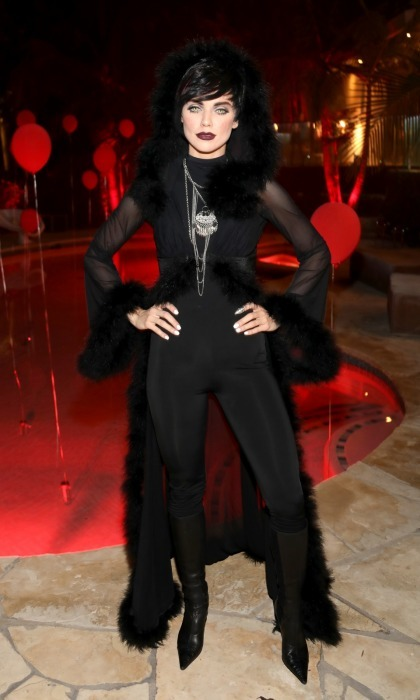 <i>90210</i> alum AnnaLynne McCord sported a gothic ensemble at the Just Jared Halloween party. She was one of the first guests to arrive at the ghoulish event. The 30-year-old actress wore a tight black leotard, chic wig and sheer robe. She topped off the look with dark lipstick and haunting green eye contacts.