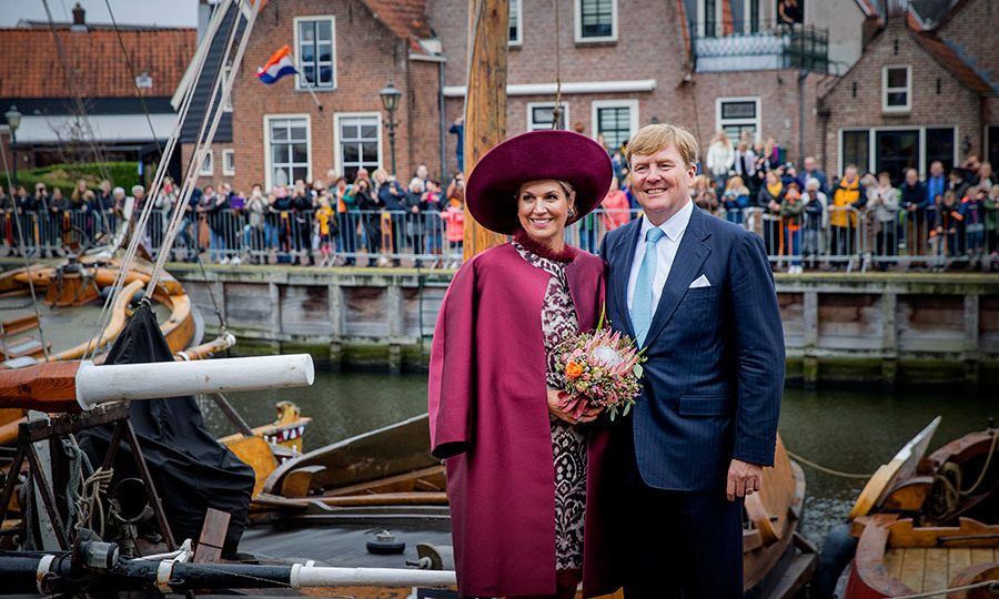 Looking like they could be on a romantic holiday – if not for the crowds of wellwishers in the background giving it away! – King Willem-Alexander and Queen Maxima of the Netherlands struck a pose while visiting Spakenburg on October 24 in Soest, Netherlands. 