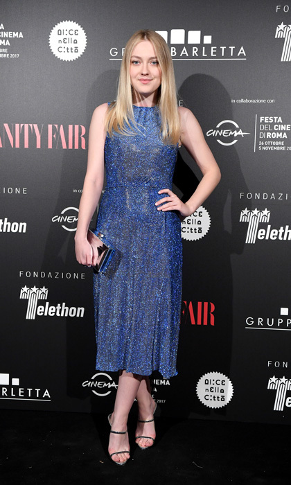 Dakota Fanning wore a sparkly blue sleeveless dress by Dolce & Gabbana to the Telethon Gala during the 12th Rome Film Festival at Villa Miani. The blonde beauty accessorized with a silver clutch and strappy heels.
