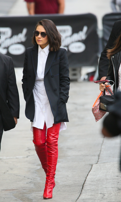 Mila Kunis was definitely a girl on fire in red thigh high Fendi boots. The <i>A Bad Moms Christmas</i> actress wore the high-end label head to toe for her appearance on <i>Jimmy Kimmel Live</i>. She added a pair of Prive Reveaux sunglasses to complete the look.